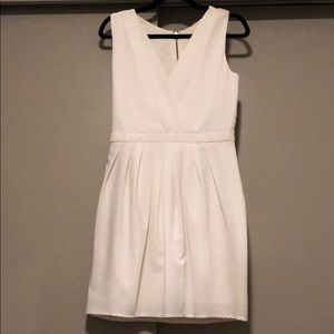 Cream v neck dress with beautiful rose back detail